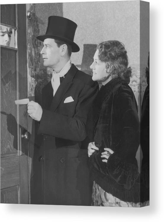 Young Men Canvas Print featuring the photograph Couple In Formal Wear Showing Pass To by Fpg
