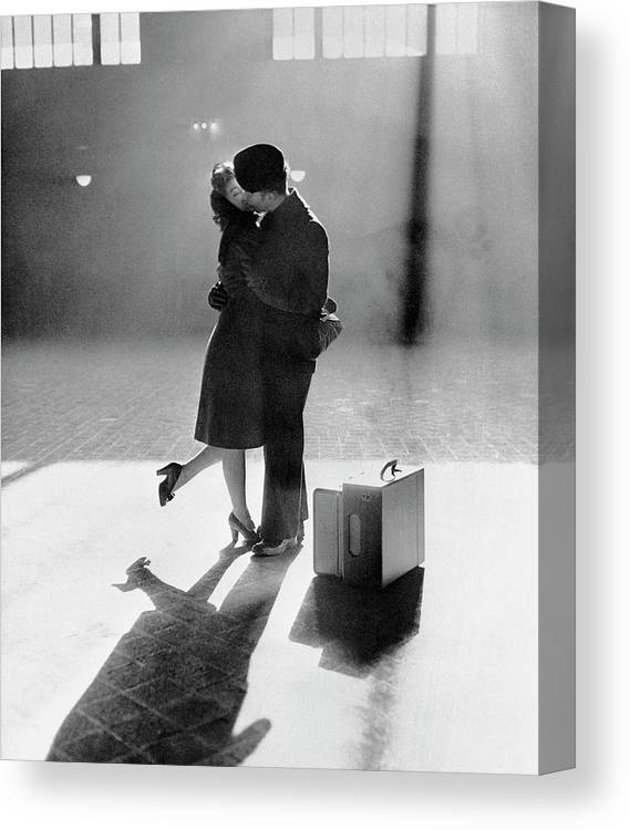 Shadow Canvas Print featuring the photograph Couple Kissing In Train Station by Bettmann