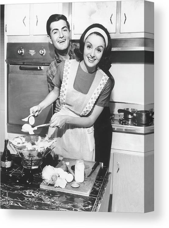 Heterosexual Couple Canvas Print featuring the photograph Couple Standing In Kitchen, Smiling, B&w by George Marks