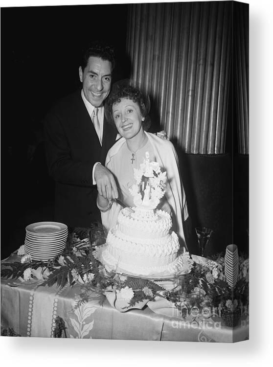 Following Canvas Print featuring the photograph Edith Piaf Cuts Wedding Cake by Bettmann