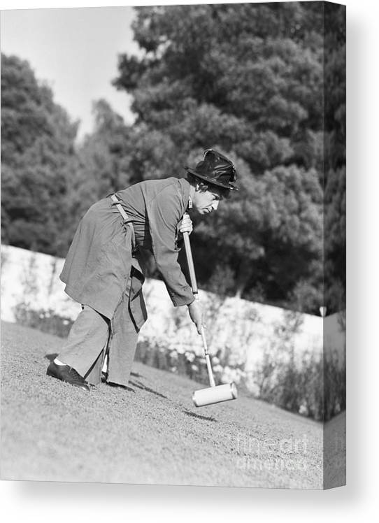 People Canvas Print featuring the photograph Harpo Marx Playing Croquet by Bettmann