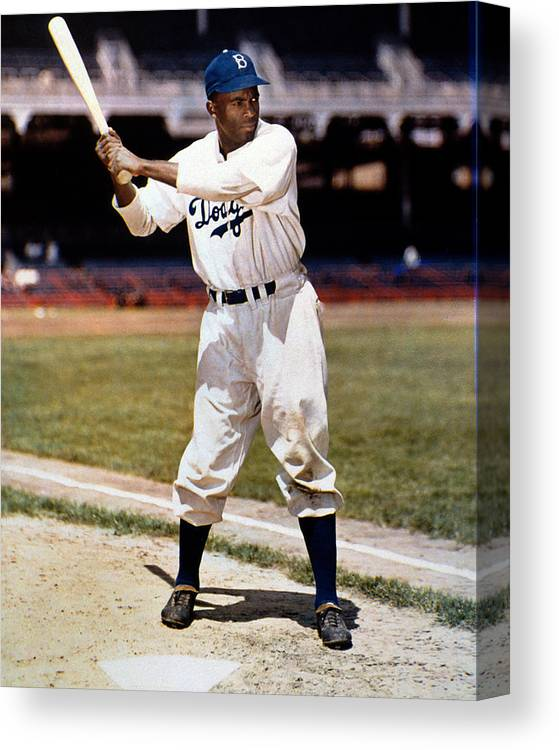 Jackie Robinson Canvas Print featuring the photograph Jackie Robinson Of The Brooklyn Dodgers by New York Daily News Archive