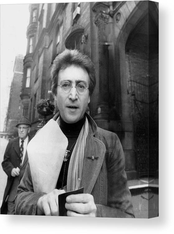 Apartment Canvas Print featuring the photograph John Lennon Returning From Florist Shop by New York Daily News Archive