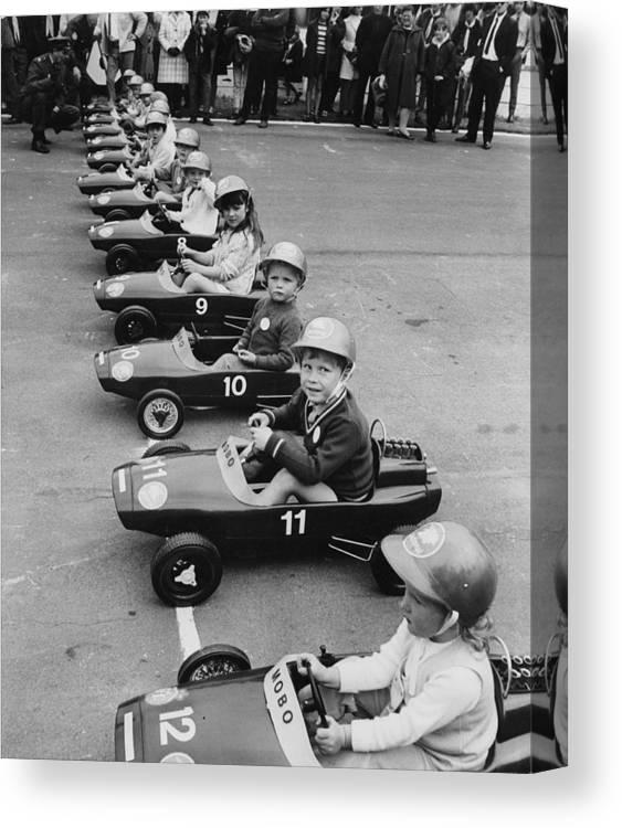 Crash Helmet Canvas Print featuring the photograph Junior Grand Prix by Douglas Miller