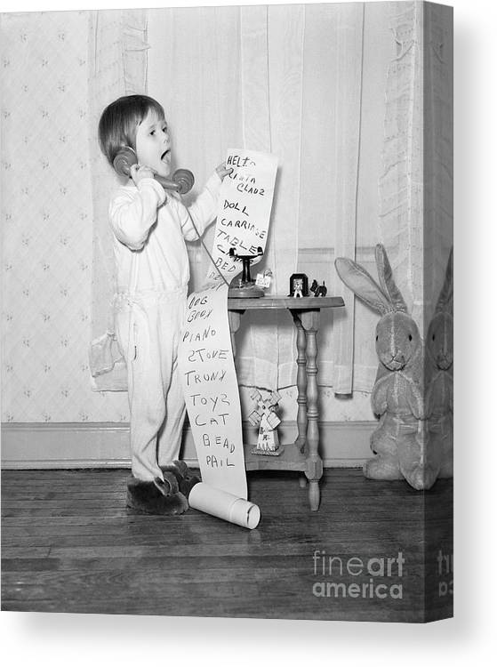 Toddler Canvas Print featuring the photograph Little Girl On The Phone To Santa by Bettmann