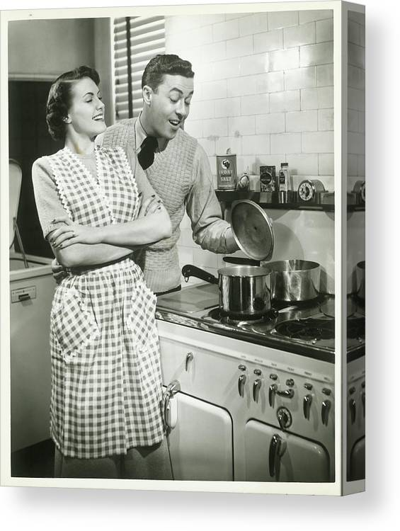 Heterosexual Couple Canvas Print featuring the photograph Man Looking Into Pot In Domestic by George Marks