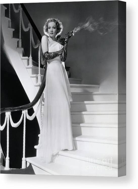 Smoking Canvas Print featuring the photograph Marlene Dietrich Smoking On Staircase by Bettmann