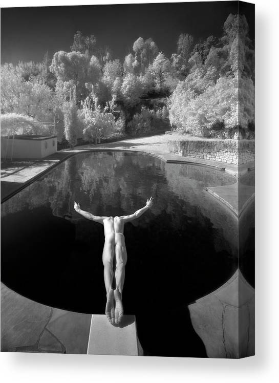 Diving Into Water Canvas Print featuring the photograph Nude Male Diving Into Dark Poolicarus by Ed Freeman