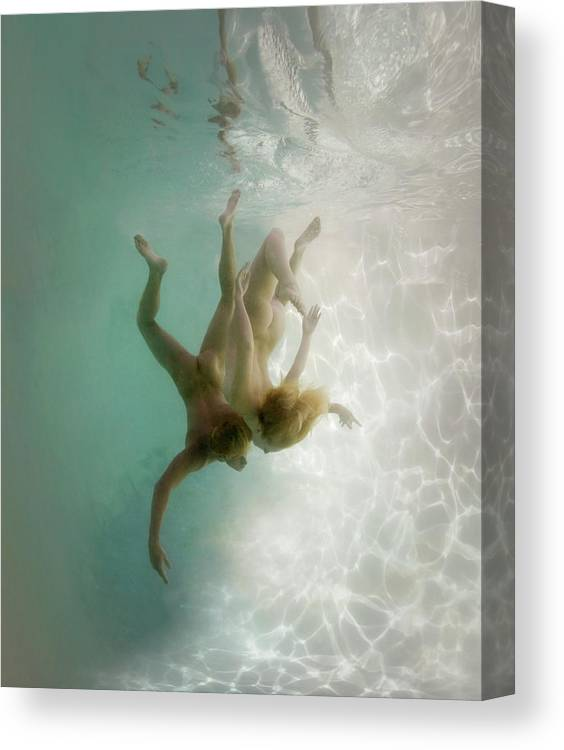 Young Men Canvas Print featuring the photograph Nude Man And Woman Underwater by Ed Freeman