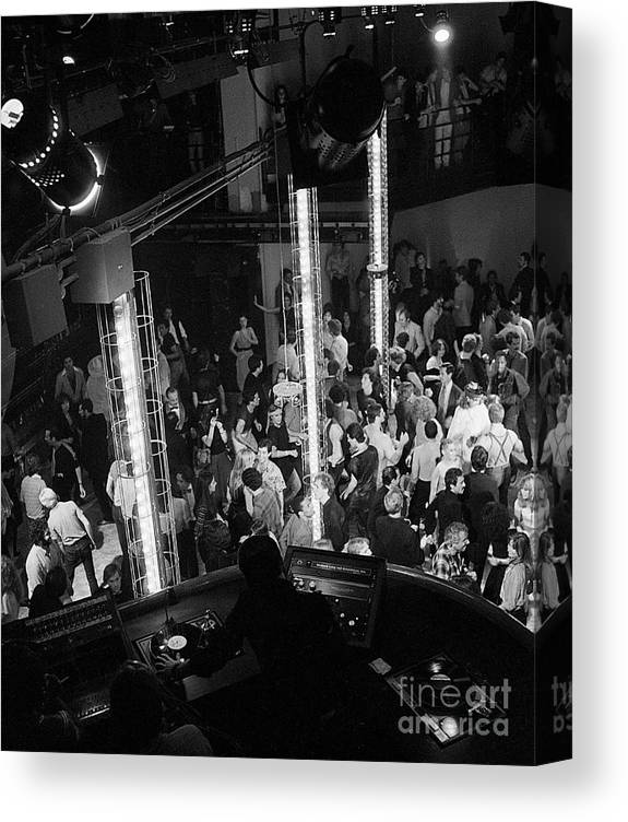 Crowd Of People Canvas Print featuring the photograph People Dancing At Studio 54 by Bettmann