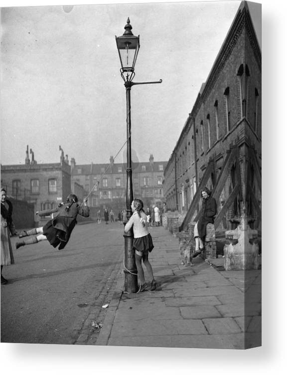 Child Canvas Print featuring the photograph Playing In Street by Haywood Magee