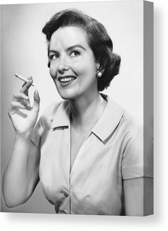 Smoking Canvas Print featuring the photograph Portrait Of Woman Holding Cigarettte by George Marks