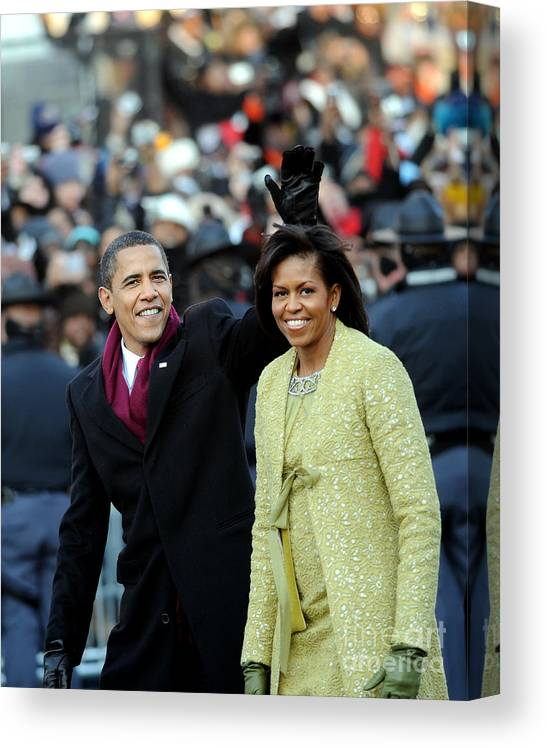 Inauguration Into Office Canvas Print featuring the photograph President Barack Obama And First Lady by New York Daily News Archive