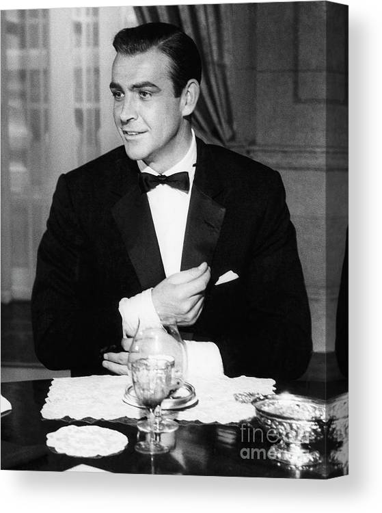Adjusting Canvas Print featuring the photograph Sean Connery As James Bond In Goldfinger by Bettmann