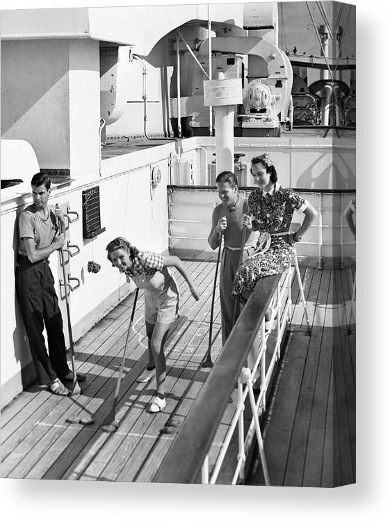 Heterosexual Couple Canvas Print featuring the photograph Shuffleboard Players by George Marks