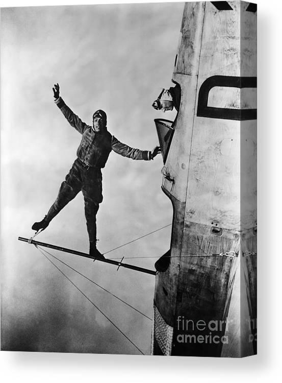 Aerobatics Canvas Print featuring the photograph Stunt Flier Suspended Over Cockpit by Bettmann