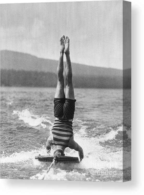 People Canvas Print featuring the photograph Stunt Man Performing Aquaplane Feat by Bettmann