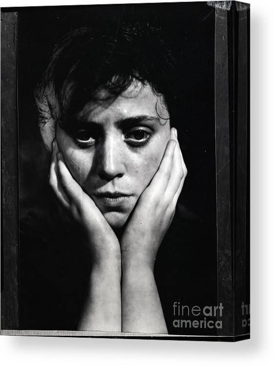 People Canvas Print featuring the photograph Woman Holding Her Head by Bettmann