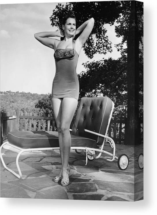People Canvas Print featuring the photograph Woman In Bathing Suit Outdoors by George Marks