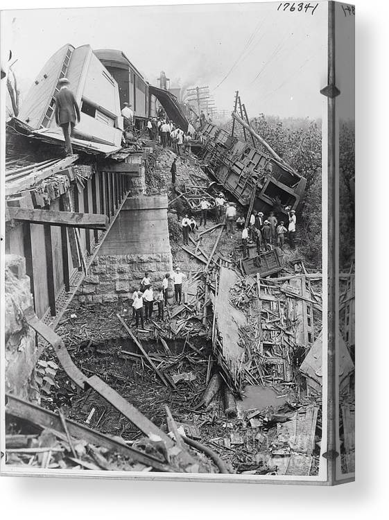 People Canvas Print featuring the photograph Workers On Train Wreck Debris by Bettmann