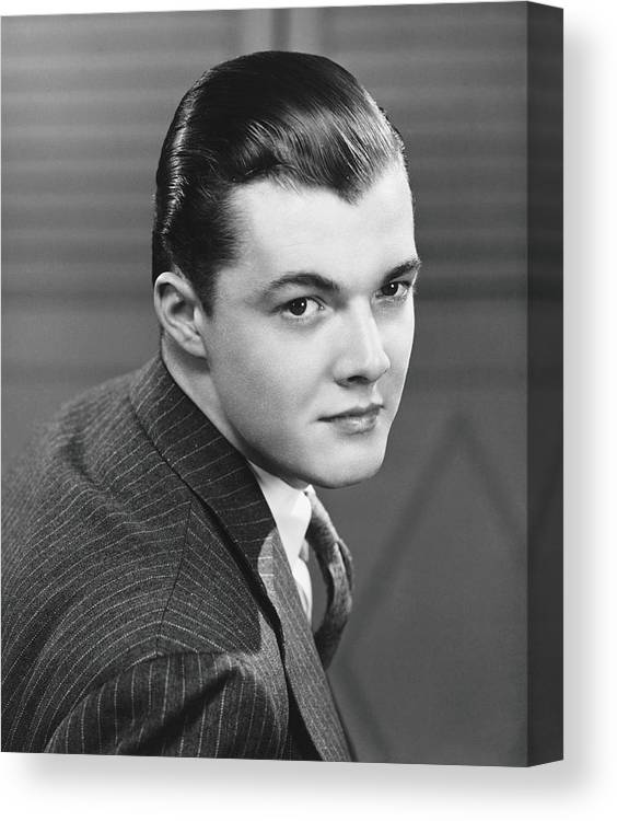 Young Men Canvas Print featuring the photograph Young Man Wearing Pinstripe Jacket by George Marks