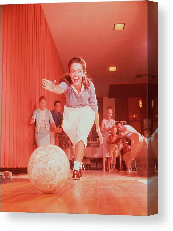People Canvas Print featuring the photograph Young Woman Bowling, Family Watching In by Fpg