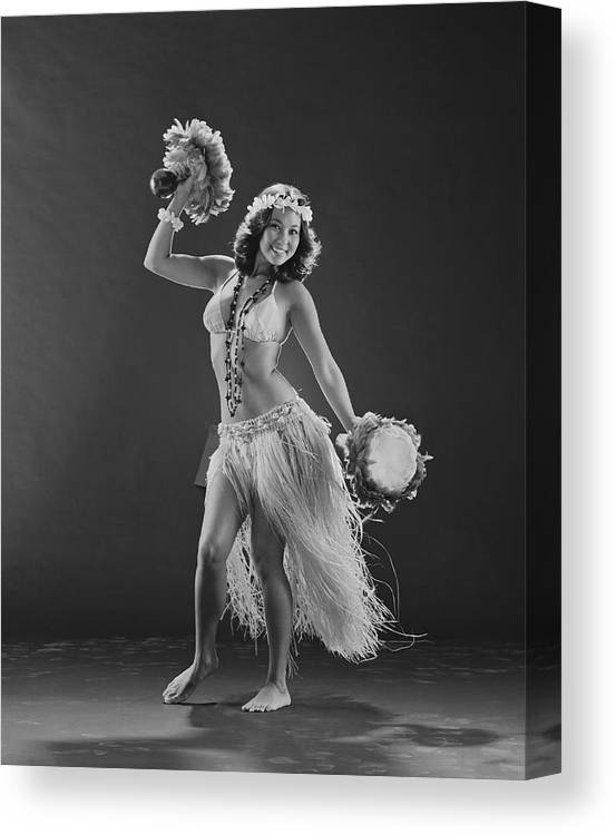 People Canvas Print featuring the photograph Young Woman Hula Dancer With Feathered by Tom Kelley Archive
