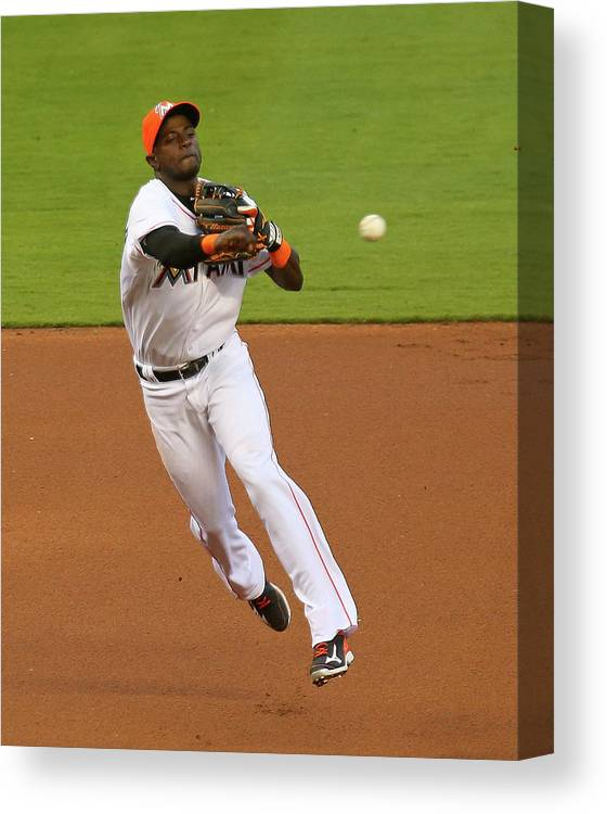 American League Baseball Canvas Print featuring the photograph Adeiny Hechavarria by Mike Ehrmann