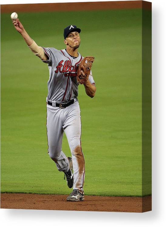 People Canvas Print featuring the photograph Andrelton Simmons by Mike Ehrmann