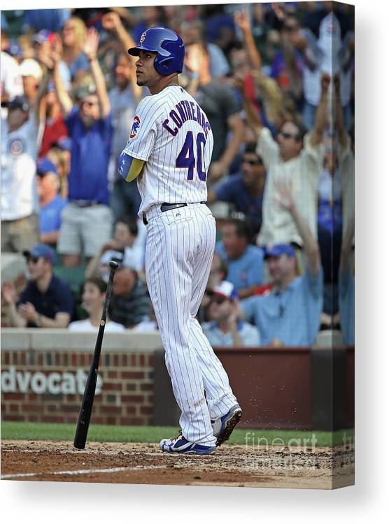Following Canvas Print featuring the photograph Willson Contreras by Jonathan Daniel