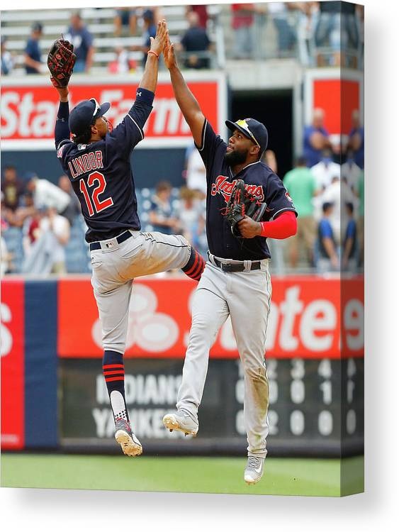 People Canvas Print featuring the photograph Abraham Almonte and Francisco Lindor by Jim Mcisaac