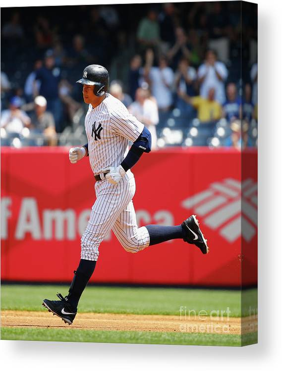 People Canvas Print featuring the photograph Alex Rodriguez, Eric Hosmer, and Chris Young by Al Bello