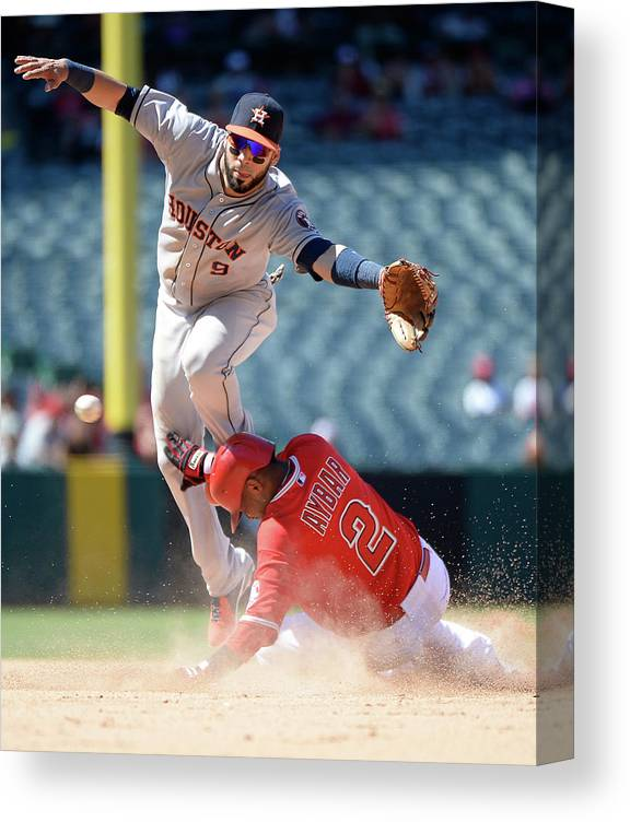 American League Baseball Canvas Print featuring the photograph Carlos Corporan and Erick Aybar by Harry How