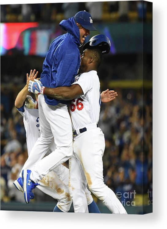 Ninth Inning Canvas Print featuring the photograph Clayton Kershaw and Yasiel Puig by Jayne Kamin-oncea