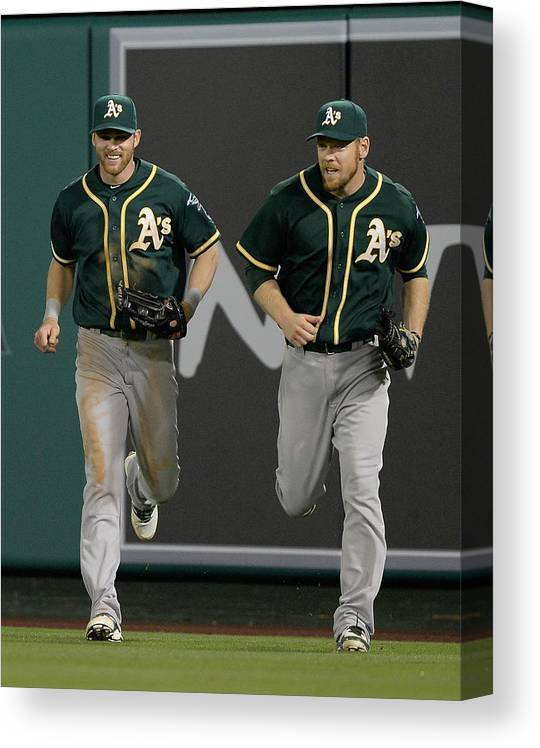 American League Baseball Canvas Print featuring the photograph Derek Norris, Howie Kendrick, and Brandon Moss by Harry How