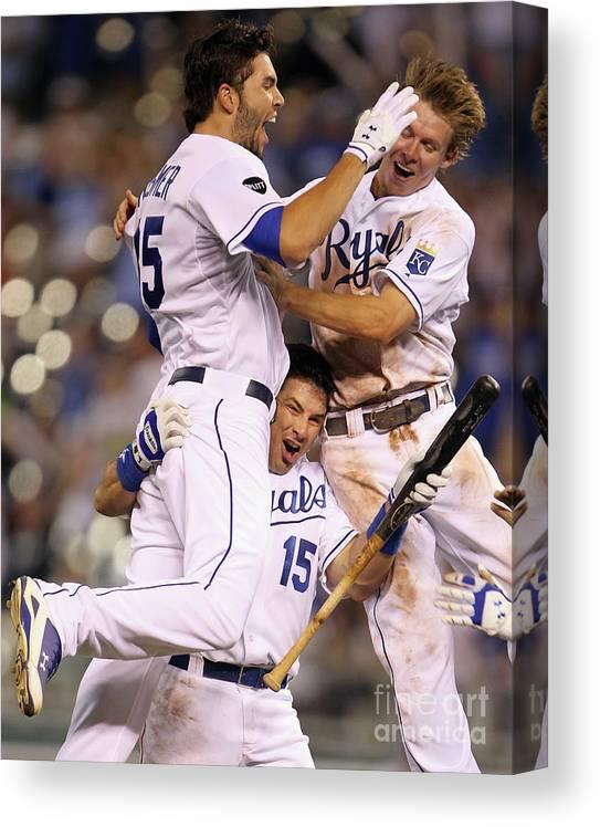 American League Baseball Canvas Print featuring the photograph Eric Hosmer, Matt Treanor, and Chris Getz by Jamie Squire