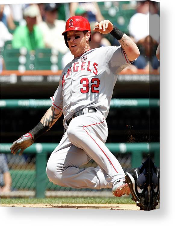 American League Baseball Canvas Print featuring the photograph Josh Hamilton and Brad Hawpe by Duane Burleson