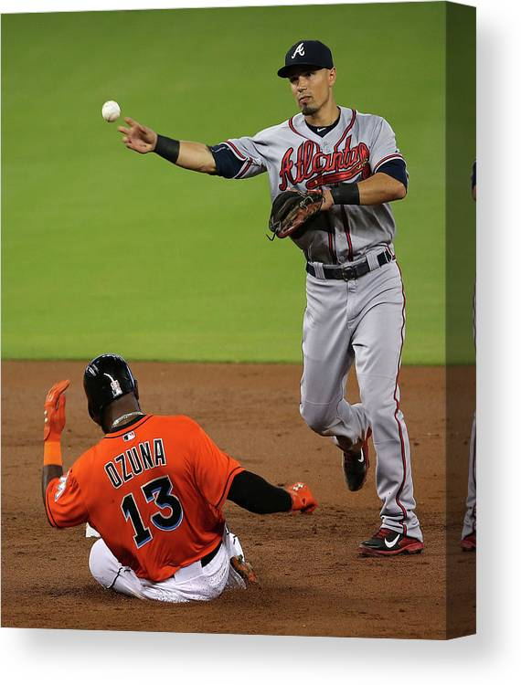 Double Play Canvas Print featuring the photograph Marcell Ozuna And Jace Peterson by Mike Ehrmann