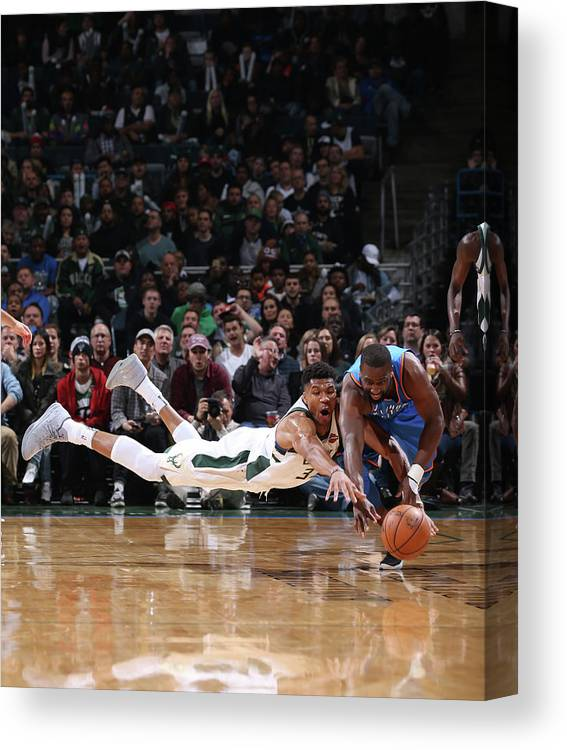 Nba Pro Basketball Canvas Print featuring the photograph Raymond Felton and Giannis Antetokounmpo by Gary Dineen