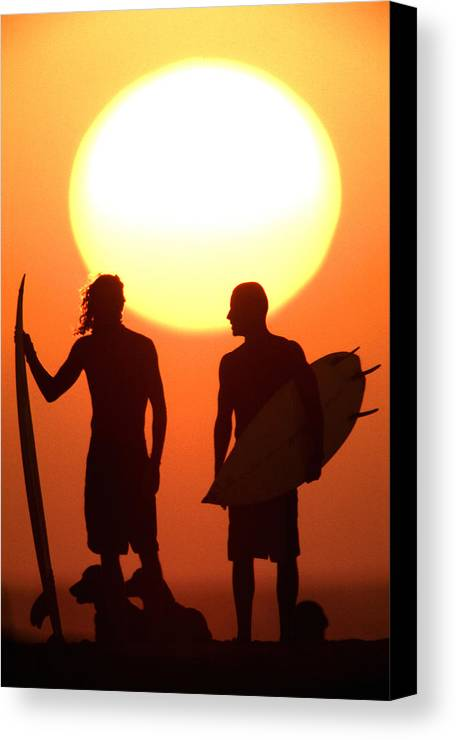 Surf Lifestyle Canvas Print featuring the photograph Sunset Surfers by Sean Davey