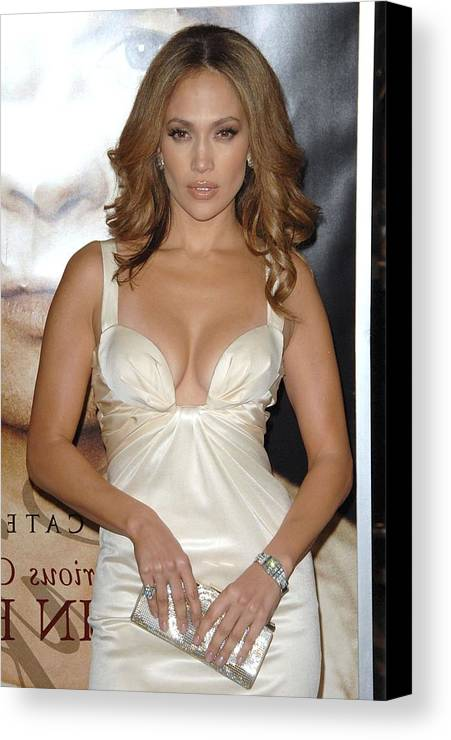 The Curious Case Of Benjamin Button Premiere Canvas Print featuring the photograph Jennifer Lopez Wearing A Roberto by Everett