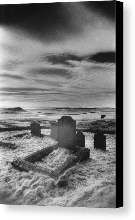 Cemetery; Graveyard; Graves; Church Yard; Tombs; Gravestones; Tombstones; Grave Stones; Bleak; Desolate; Atmospheric; Eerie; Spooky; Landscape; Rural; Countryside; Remote; Isolated; Gothic; Haunted Canvas Print featuring the photograph St Aidans Churchyard by Simon Marsden