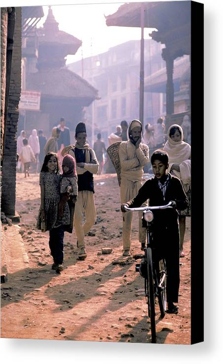 Boy Canvas Print featuring the photograph Kathmandu In Nepal by Carl Purcell