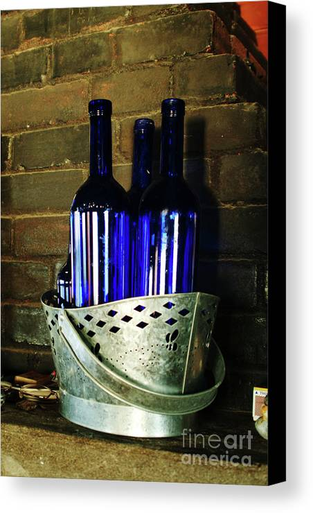 Trio Of Blue Glass Bottles In A Coal Tin On A Brick Face Fireplace Mantle In A Cottage By The Ocean At Monhegan Island Canvas Print featuring the photograph Blue Bottles by Georgia Sheron