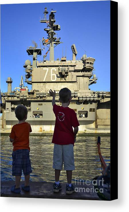 Aircraft Carrier Canvas Print featuring the photograph Children Wave As Uss Ronald Reagan by Stocktrek Images