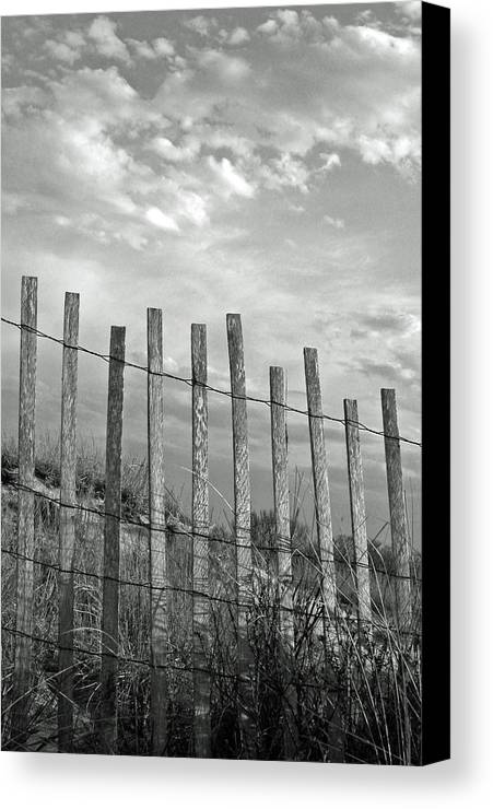 Vertical Canvas Print featuring the photograph Fence At Jones Beach State Park. New York by Gary Koutsoubis