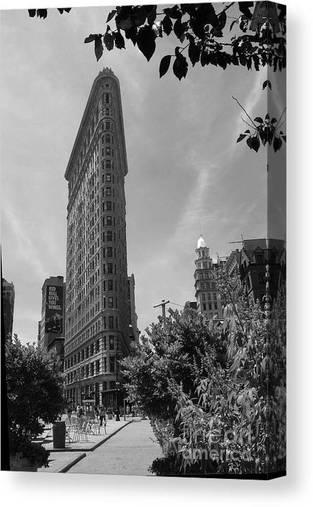 Flatiron Building Canvas Print featuring the photograph Flatiron Building Manhattan by Christiane Schulze Art And Photography