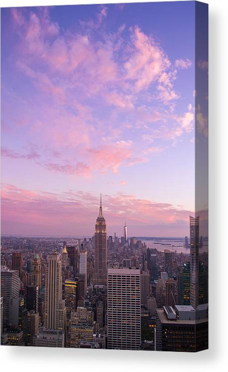 Clouds Canvas Print featuring the photograph clouds over Empire State by Rima Biswas