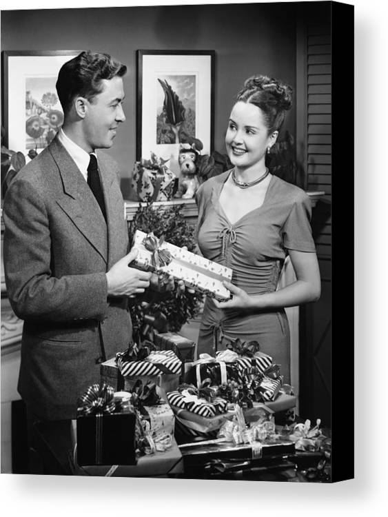 30-34 Years Canvas Print featuring the photograph Woman Giving Gift To Man, (b&w) by George Marks