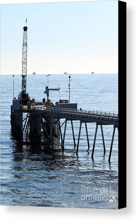 Water Canvas Print featuring the photograph Carpinteria Pier by Henrik Lehnerer